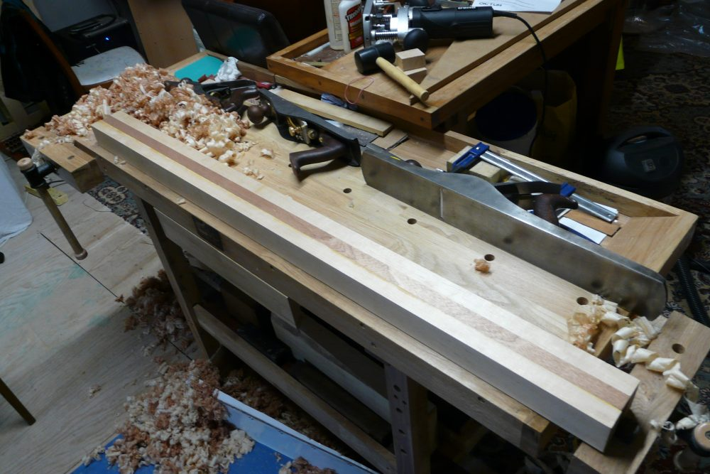 planing up a maple-utile-maple neck-through blank