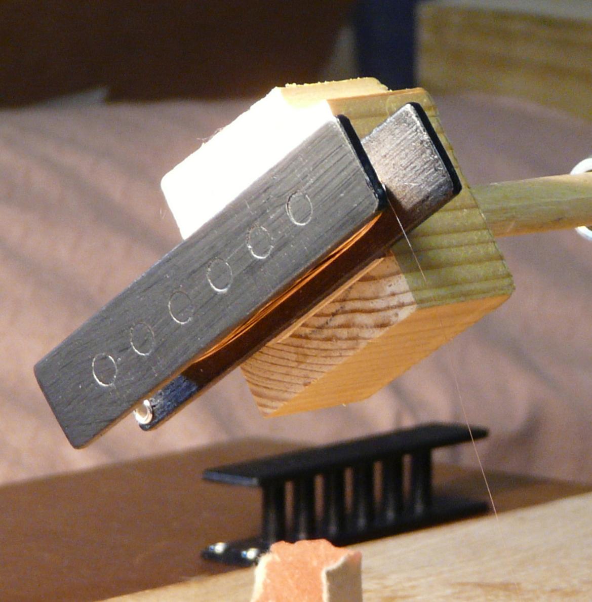 Winding one coil of guitar humbucker