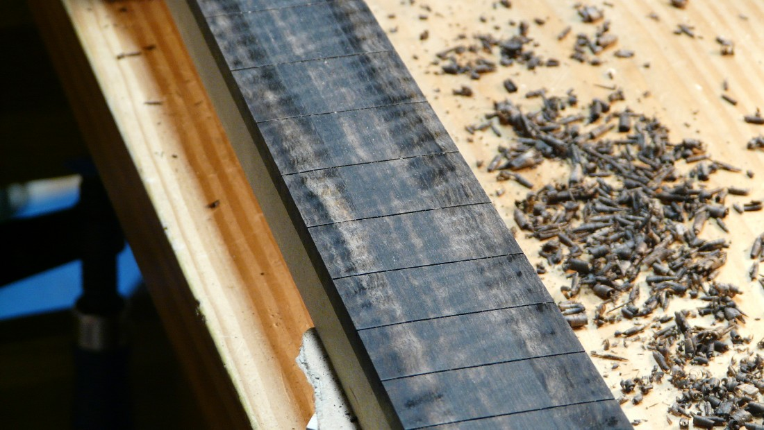 flamed ebony fingerboard